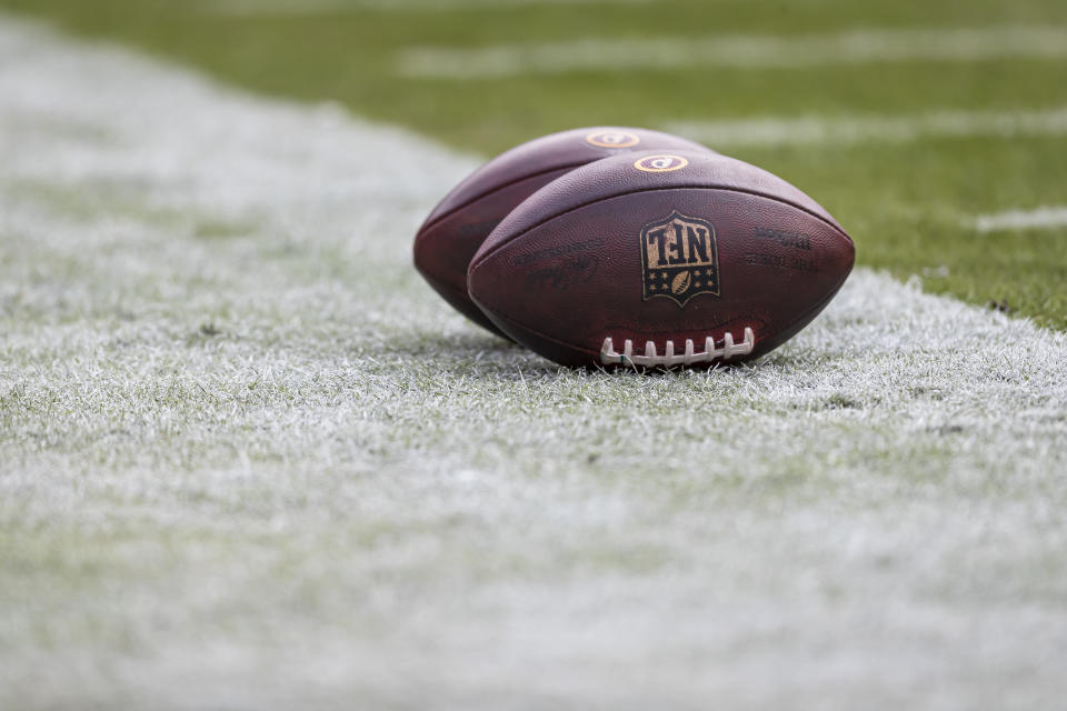 LANDOVER, MD - NOVEMBER 24: A detailed view of two official NFL footballs with Washington Redskins logos on the sidelines before the game between the Washington Redskins and the Detroit Lions at FedExField on November 24, 2019 in Landover, Maryland. (Photo by Scott Taetsch/Getty Images)