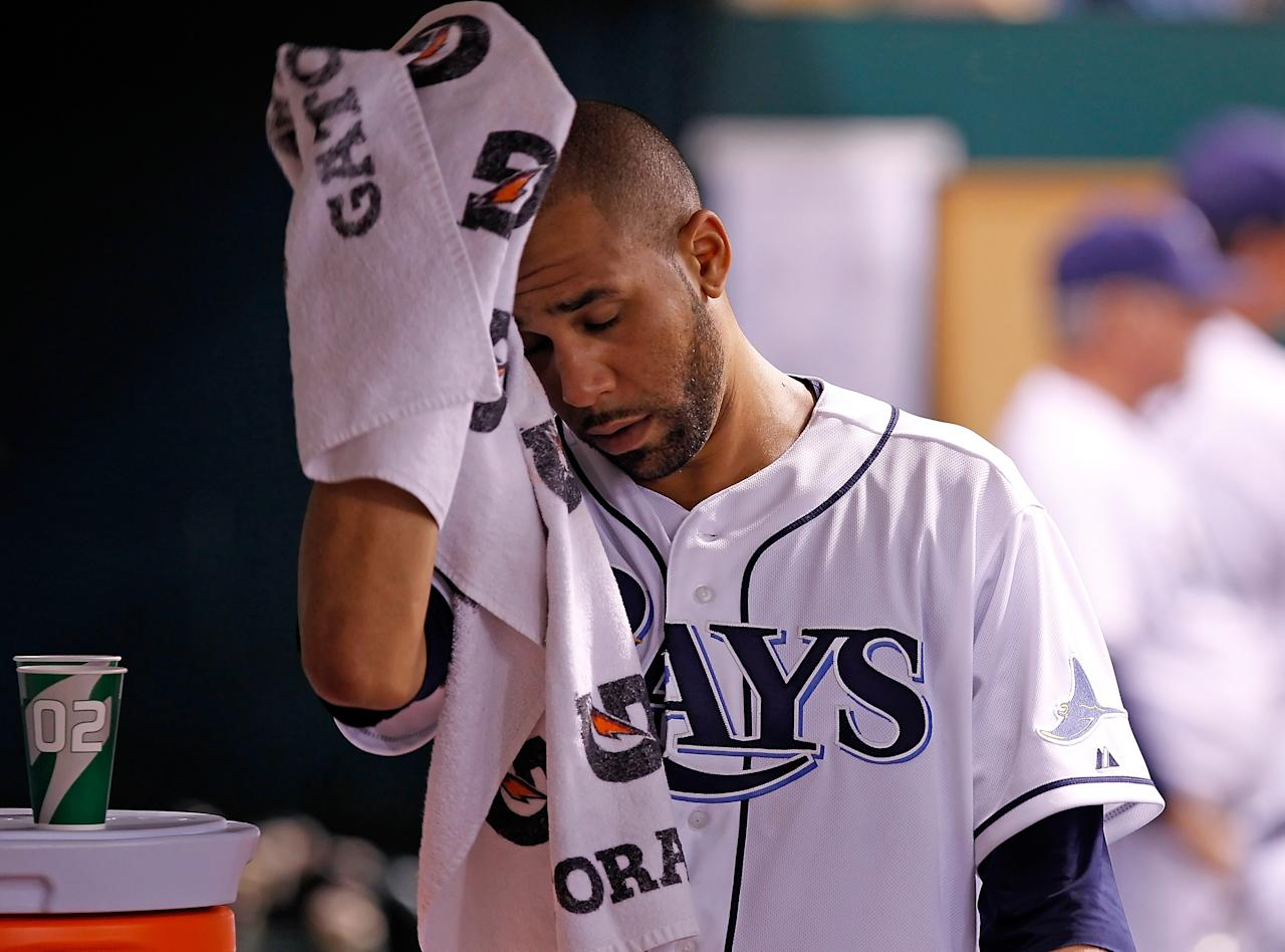 ST. PETERSBURG - JUNE 13:  Pitcher David Price #14 of the Tampa Bay Rays wipes his face after he left the game against the New York Mets at Tropicana Field on June 13, 2012 in St. Petersburg, Florida.  (Photo by J. Meric/Getty Images)