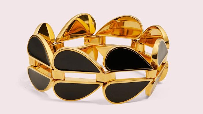 Go for bold with this black-and-gold cuff.