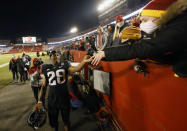 Iowa State running back Breece Hall celebrates a 42-6 win over West Virginia with fans in the stands after an NCAA college football game, Saturday, Dec. 5, 2020, in Ames, Iowa. (AP Photo/Matthew Putney)