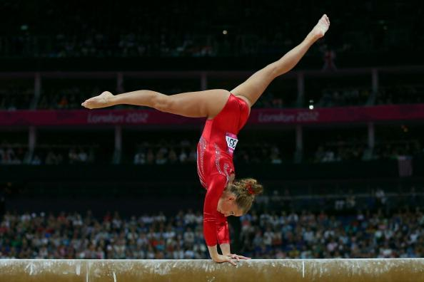 LONDON, ENGLAND - JULY 29:  Imogen Cairns of Great Britain competes on the beam in the Artistic Gymnastics Women's qualification on Day 2 of the London 2012 Olympic Games at North Greenwich Arena on July 29, 2012 in London, England.  (Photo by Cameron Spencer/Getty Images)