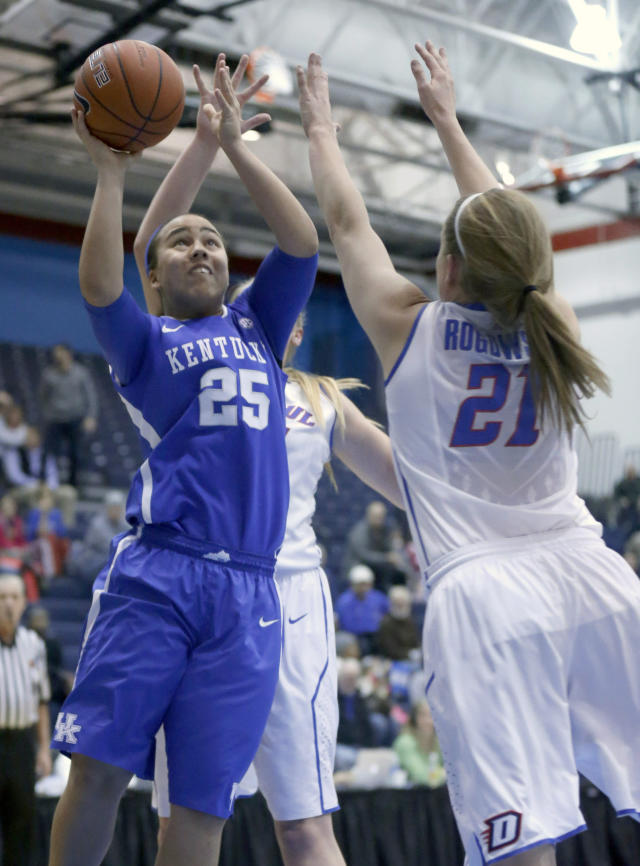 Kentucky guard Makayla Epps (25) shoots over DePaul guard Megan Rogowski (21) during the first half of an NCAA college basketball game Thursday, Dec. 12, 2013, in Chicago. (AP Photo/Charles Rex Arbogast)
