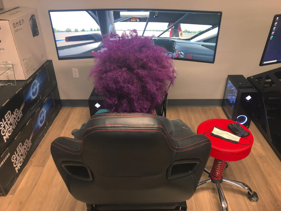 A student practices with a race simulator donated by former NASCAR driver Kyle Larson at the Urban Youth Racing School, Friday, Oct. 30, 2020, in Philadelphia. The school has made it its mission to introduce inner-city youngsters, most of them black, to the motorsports world. (AP Photo/Dan Gelston)