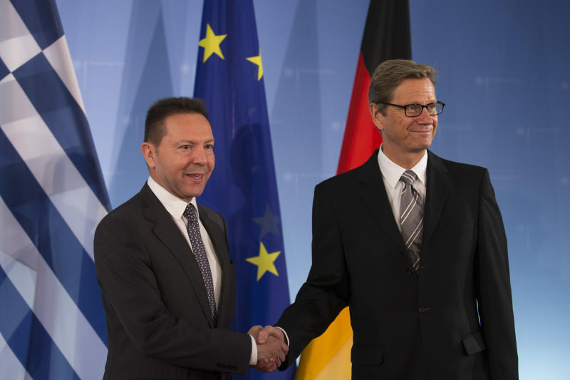 German Foreign Minister Guido Westerwelle, right, welcomes Greek Finance Minister Yiannis Stournaras, left,  for talks on the financial crisis at the foreign ministry in Berlin, Tuesday, Sept. 4, 2012. (AP Photo/Markus Schreiber)