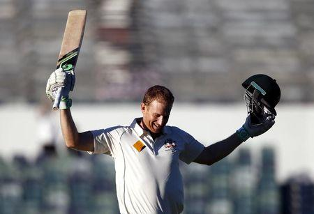 Australia's Adam Voges celebrates reaching his century during the fourth day of the second cricket test match against New Zealand at the WACA ground in Perth, Western Australia