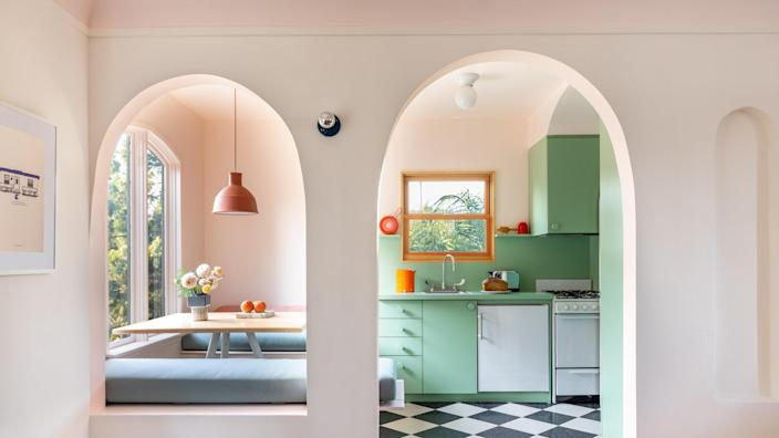 Laurel Broughton replaced rectangular doorways and detailing with elegant arches, inspired in part by an original niche located just to the right of the kitchen entry.