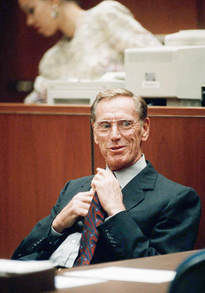 FILE - In this Thursday, Nov. 14, 1991, file photo, Charles Keating Jr., adjusts his tie as he sits in a Los Angeles courtroom. Keating, the financier who was disgraced for his role in the costliest savings and loan failure of the 1980s, has died. He was 90. A person with direct knowledge of the death confirmed that Keating died but didn't provide further details. The person wasn't authorized to release the information and spoke on condition of anonymity. (AP Photo/Nick Ut)