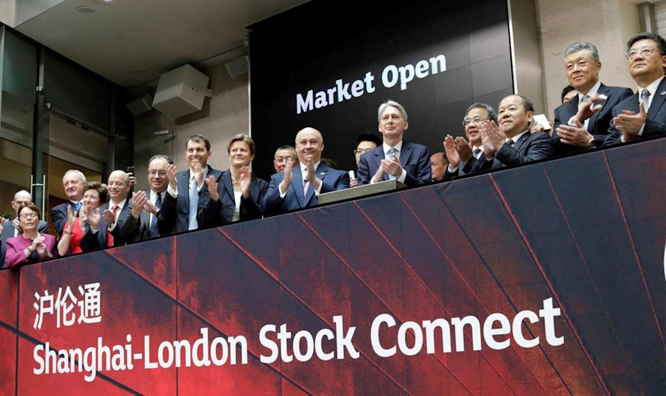 Britain's Chancellor Philip Hammond claps during a ceremony for the London-Shanghai Connect project launch in London in June 2019: Photo LSE Group handout