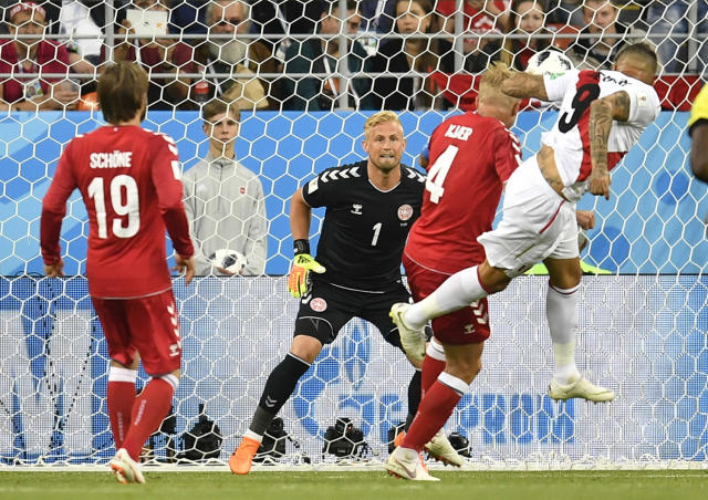 Peru's Paolo Guerrero, right, heads for the ball during the group C match between Peru and Denmark at the 2018 soccer World Cup in the Mordovia Arena in Saransk, Russia, Saturday, June 16, 2018. (AP Photo/Martin Meissner)