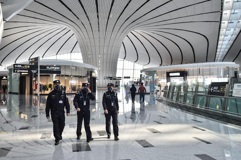 Policeman Wu Shengzao 1st L patrols with his colleagues at the Daxing International Airport in Beijing, capital of China, Feb. 1, 2020 2