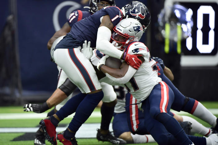 New England Patriots running back Damien Harris (37) rushes for a touchdown as Houston Texans' Lonnie Johnson Jr. defends during the first half of an NFL football game Sunday, Oct. 10, 2021, in Houston. (AP Photo/Justin Rex)