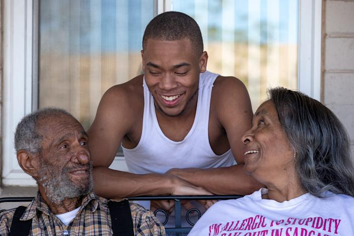 Gentry Gray, 84, Alexander Nicholes, 16, and Victoria Gray, 69, talk on their front patio on Dec. 9, 2020, at their home in Phoenix.