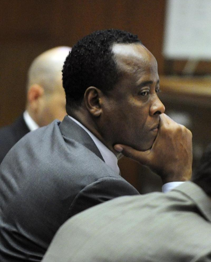 Dr. Conrad Murray listens to character witness testimony  during his  involuntary manslaughter trial  in Los Angeles on Wednesday, Oct. 26, 2011.  Murray has pleaded not guilty and faces four years in prison and the loss of his medical licenses if convicted of involuntary manslaughter in Michael Jackson's death.  (AP Photo/Paul Buck, Pool)