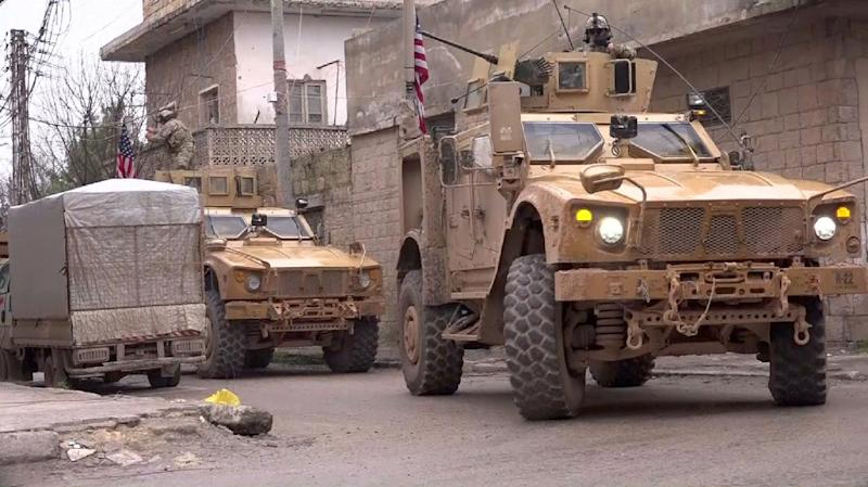 US armoured vehicles in the northern Syrian city of Manbij at the scene of a January 16 suicide attack which killed 19, including four Americans (AFP Photo/-)