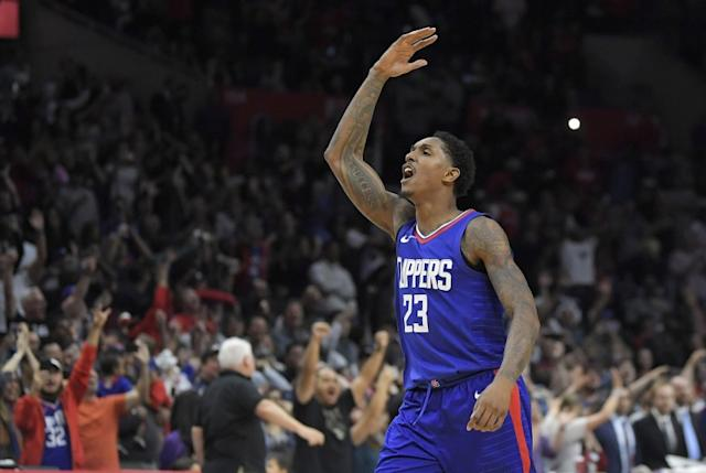 """Clippers guard Lou Williams celebrates after scoring late in a game against the Wizards. <span class=""""copyright"""">(Mark J. Terrill / Associated Press)</span>"""
