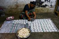 Some jubilant locals laid out hundreds of Chakkali -- a popular south Indian spiral snack