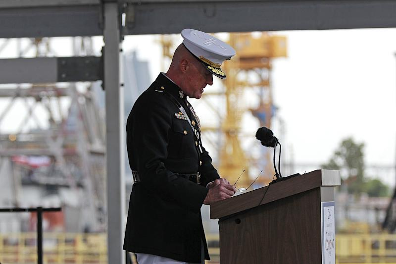 File - USMC Lt. Gen. Richard Mills speaks during christening ceremonies for the USS Somerset at the Huntington Ingalls Industries shipyard Shipyard in Avondale, La., in this  Saturday, July 28, 2012 file photo. The U.S. military has been launching cyberattacks against its opponents in Afghanistan, a senior officer said last week, making an unusually explicit acknowledgment of the oft-hidden world of electronic warfare. Marine Lt. Gen. Richard P. Mills' comments came at a conference in Baltimore during which he explained how U.S. commanders considered cyberweapons an important part of their arsenal. (AP Photo / Gerald Herbert, file)