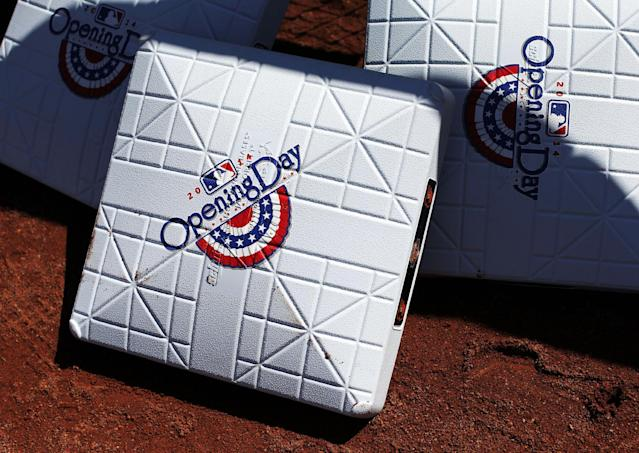 Bases sit on the warning track before an opening day baseball game between the Baltimore Orioles and the Boston Red Sox, Monday, March 31, 2014, in Baltimore. (AP Photo/Patrick Semansky)