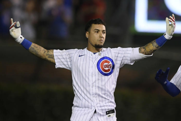 Chicago Cubs' Javier Baez celebrates after hitting a walk-off single in the ninth inning to defeat the Cincinnati Reds 6-5 in a baseball game, late Monday, July 26, 2021, in Chicago. (AP Photo/Paul Beaty)