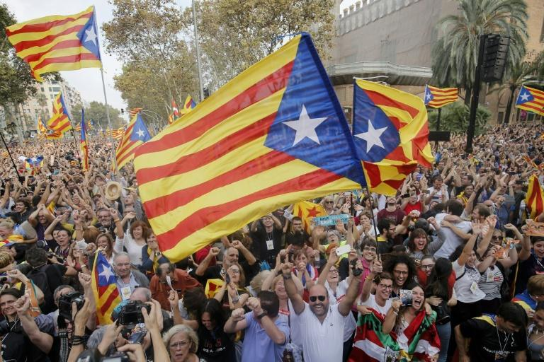 People celebrating after Catalonia's parliament voted to declare independence from Spain in 2017