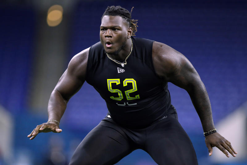 FILE - In this Feb. 28, 2020, file photo, Georgia offensive lineman Isaiah Wilson runs a drill at the NFL football scouting combine in Indianapolis. The Tennessee Titans have placed their top draft pick, offensive lineman Isaiah Wilson, on the COVID-19/reserve list. The former Georgia star remains the one member of their six-man draft class that has yet to agree to a contract. (AP Photo/Michael Conroy, File)
