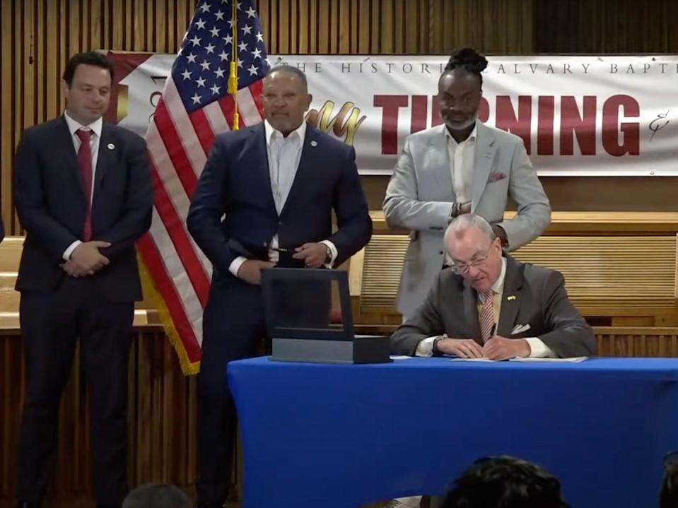 Democratic New Jersey Governor Phil Murphy signs the Fair Chance in Housing Act on 18 June 2021.  (The office of the governor of New Jersey)
