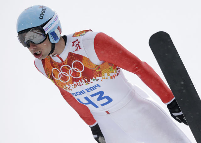 France's Jason Lamy Chappuis makes his trial jump during the Nordic combined individual Gundersen large hill competition at the 2014 Winter Olympics, Tuesday, Feb. 18, 2014, in Krasnaya Polyana, Russia. (AP Photo/Matthias Schrader)