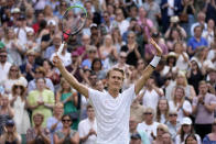 Sebastian Korda of the US celebrates winning the men's singles third round match against Britain's Daniel Evans on day five of the Wimbledon Tennis Championships in London, Friday July 2, 2021. (AP Photo/Kirsty Wigglesworth)