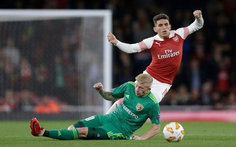 Lucas Torreira of Arsenal is fouled by Vladyslav Kulach of Vorskla Poltava during the UEFA Europa League Group E match between Arsenal and Vorskla Poltava at Emirates Stadium - Credit: Henry Browne/Getty Images