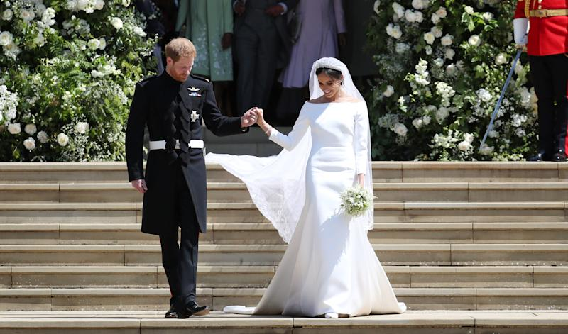 The Duchess of Sussex, née Meghan Markle, married Prince Harry in an off-the-shoulder Givenchy dress in May 2018. (Getty Images)