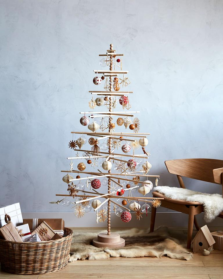 <p>Crafts editor Silke Stoddard evokes a hygge holiday with her Christmas tree. When she&nbsp;recalls her childhood in&nbsp;D&uuml;sseldorf, Germany,&nbsp;the family used a&nbsp;natural minimalist design seen replicated&nbsp;here:&nbsp;a wooden-dowel tree with a mix of handmade&nbsp;straw and wood ornaments,&nbsp;bone-bead snowflakes and temari balls.</p>