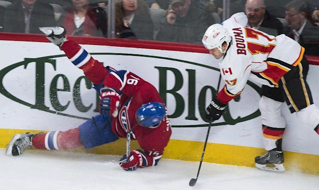 Montreal Canadiens' P.K. Subban, left, is upended by Calgary Flames' Lance Bouma during the first period of an NHL hockey game Tuesday, Feb. 4, 2014, in Montreal. (AP Photo/The Canadian Press, Graham Hughes)