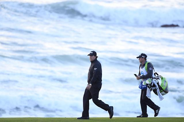 """<div class=""""caption""""> Mickelson walks with his brother/caddie, Tim, on the 10th hole during the final round of last year's Pebble Beach Pro-Am. </div> <cite class=""""credit"""">Harry How/Getty Images</cite>"""