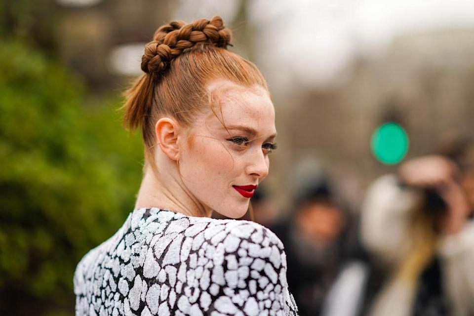 <p>Copper hair woven into intricately braided updos looks instantly ethereal.</p>