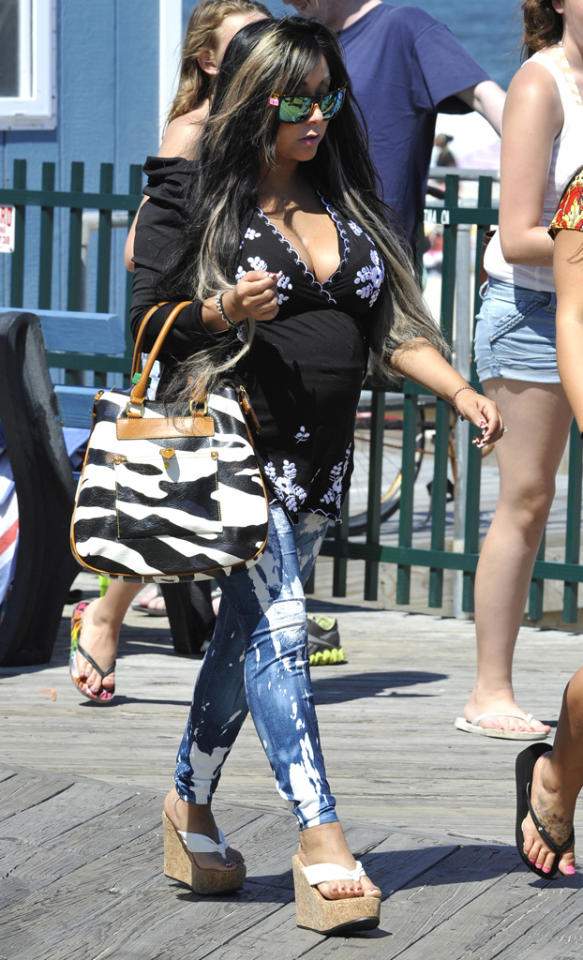 Snooki keeps it casual in a pair of wedge sandals back in Seaside Heights, New Jersey on June 15, 2012.