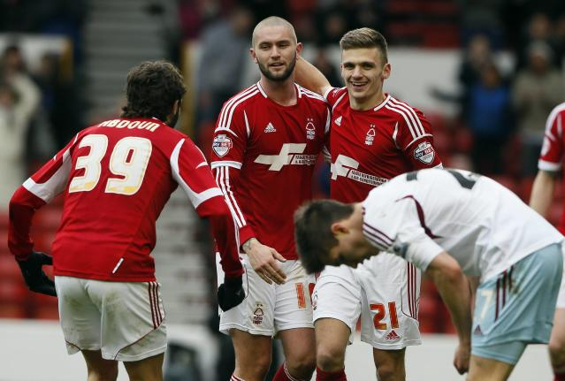 Nottingham Forest's Jamie Paterson (21) celebrates scoring against West Ham United during their FA Cup third round soccer match at City Ground in Nottingham January 5, 2014. REUTERS/Stefan Wermuth (BRITAIN - Tags: SPORT SOCCER)