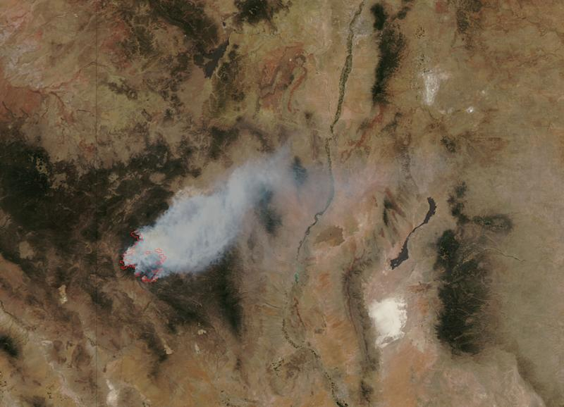 This image provided by NASA shows the massive wildfire in New Mexico's Gila National Forest acquired by the Moderate Resolution Imaging Spectroradiometer (MODIS) sensor on NASA's Aqua satellite Tuesday May 29, 2012. The wildfire, already the largest in state history, spread in all directions Thursday May 31, 2012 and experts say it's likely a preview of things to come as states across the West contend with a dangerous recipe of wind, low humidity and tinder-dry fuels. Lightning started the Whitewater-Baldy fire on May 16, and more than a thousand firefighters have battled the blaze since then. (AP Photo/NASA)