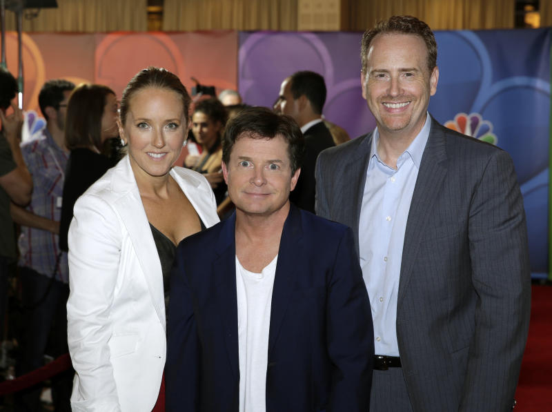 "This image released by NBC shows, NBC Entertainment President Jennifer Salke, left, and Entertainment Chairman Robert Greenblatt, right, with actor Michael J. Fox during the Television Critics Association summer press tour in Beverly Hills, Calif., on Saturday, July 27, 2013. Fox will star in ""The Michael J. Fox Show,"" as Mike Henry, a former local NBC newscaster with Parkinson's. (AP Photo/NBC, Paul Drinkwater)"