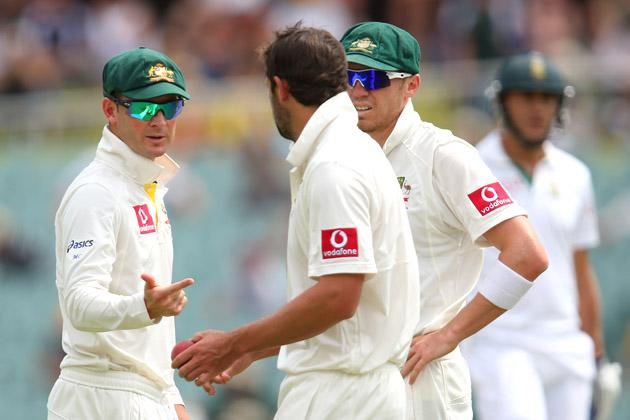 Australian captain Michael Clarke talks to team mate Ben Hilfenhaus during day five of the Second Test Match between Australia and South Africa at Adelaide Oval on November 26, 2012 in Adelaide, Australia.  (Photo by Cameron Spencer/Getty Images)