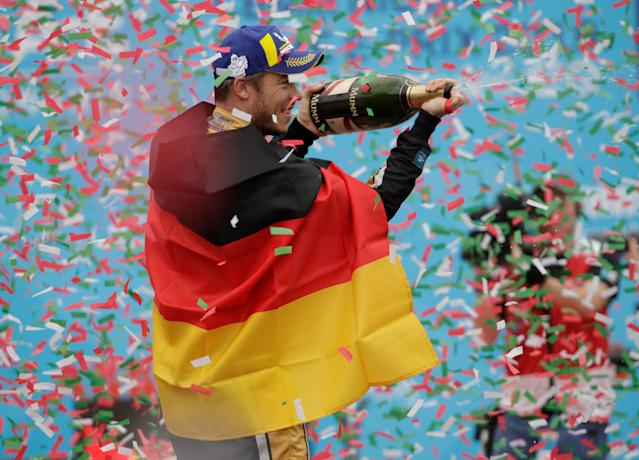 Motor Racing - Formula E - Rome ePrix - Rome, Italy - April 14, 2018 Techeetah's Andre Lotterer celebrates finishing third by spraying Champagne during the podium ceremony REUTERS/Max Rossi