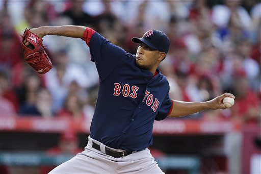 Boston Red Sox starting pitcher Felix Doubront throws against the Los Angeles Angels during the first inning of a baseball game in Anaheim, Calif., Friday, July 5, 2013. (AP Photo/Jae C. Hong)