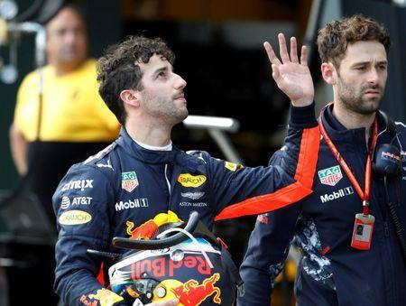Formula One - F1 - Australian Grand Prix - Melbourne, Australia - 25/03/2017 Red Bull Racing driver Daniel Ricciardo of Australia waves to fans as he walks down pit lane after crashing out of the qualifying session. REUTERS/Brandon Malone