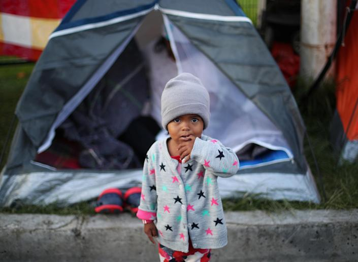 A migrant child, part of a caravan headed to the U.S., at a makeshift camp in Mexico City in November. (Photo: Hannah McKay/Reuters)