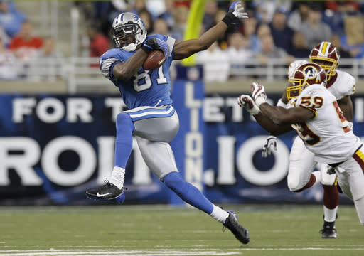 FILE - In this Oct. 26, 2008, file photo, Detroit Lions wide receiver Calvin Johnson makes catch against the Washington Redskins in the fourth quarter of an NFL football game in Detroit. Johnson, in his first-year of eligibility, was selected as a finalist for the Pro Football Hall of Fame's class of 2021 on Tuesday, Jan. 5, 2021. (AP Photo/Paul Sancya, File)