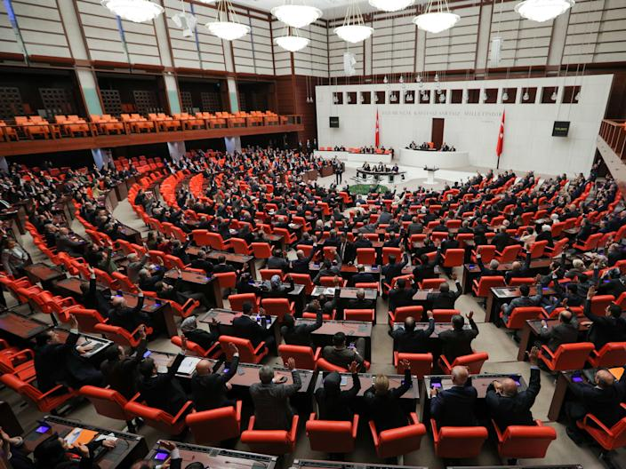 FILE PHOTO: Turkish lawmakers vote a bill that allows troop deployment to Libya, at the Parliament in Ankara, Turkey, January 2, 2020. REUTERS/Stringer