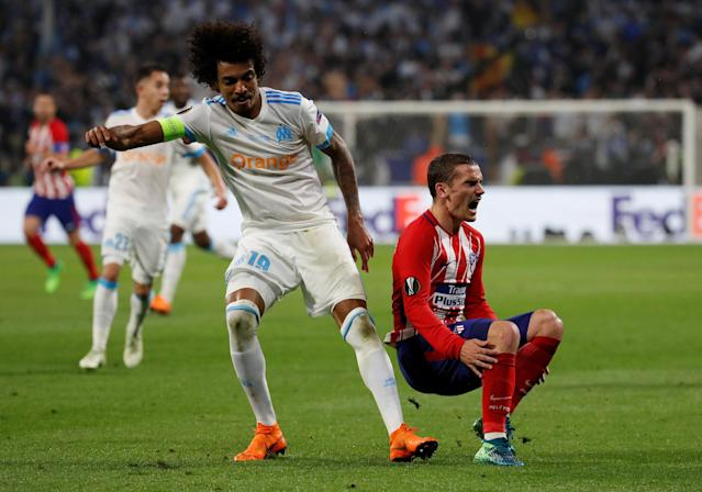 Soccer Football - Europa League Final - Olympique de Marseille vs Atletico Madrid - Groupama Stadium, Lyon, France - May 16, 2018 Atletico Madrid's Antoine Griezmann reacts while he is in action with Marseille's Luiz Gustavo REUTERS/Christian Hartmann