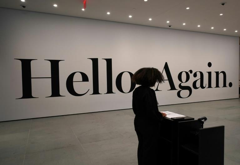 A message welcomes the public to the newly renovated Museum of Modern Art in New York (AFP Photo/TIMOTHY A. CLARY)