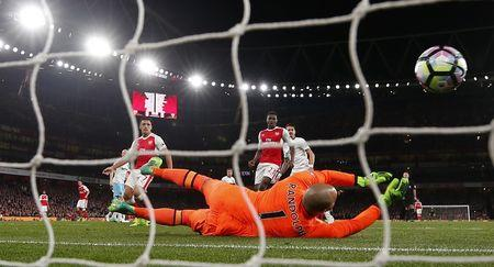 Arsenal's Mesut Ozil scores their first goal