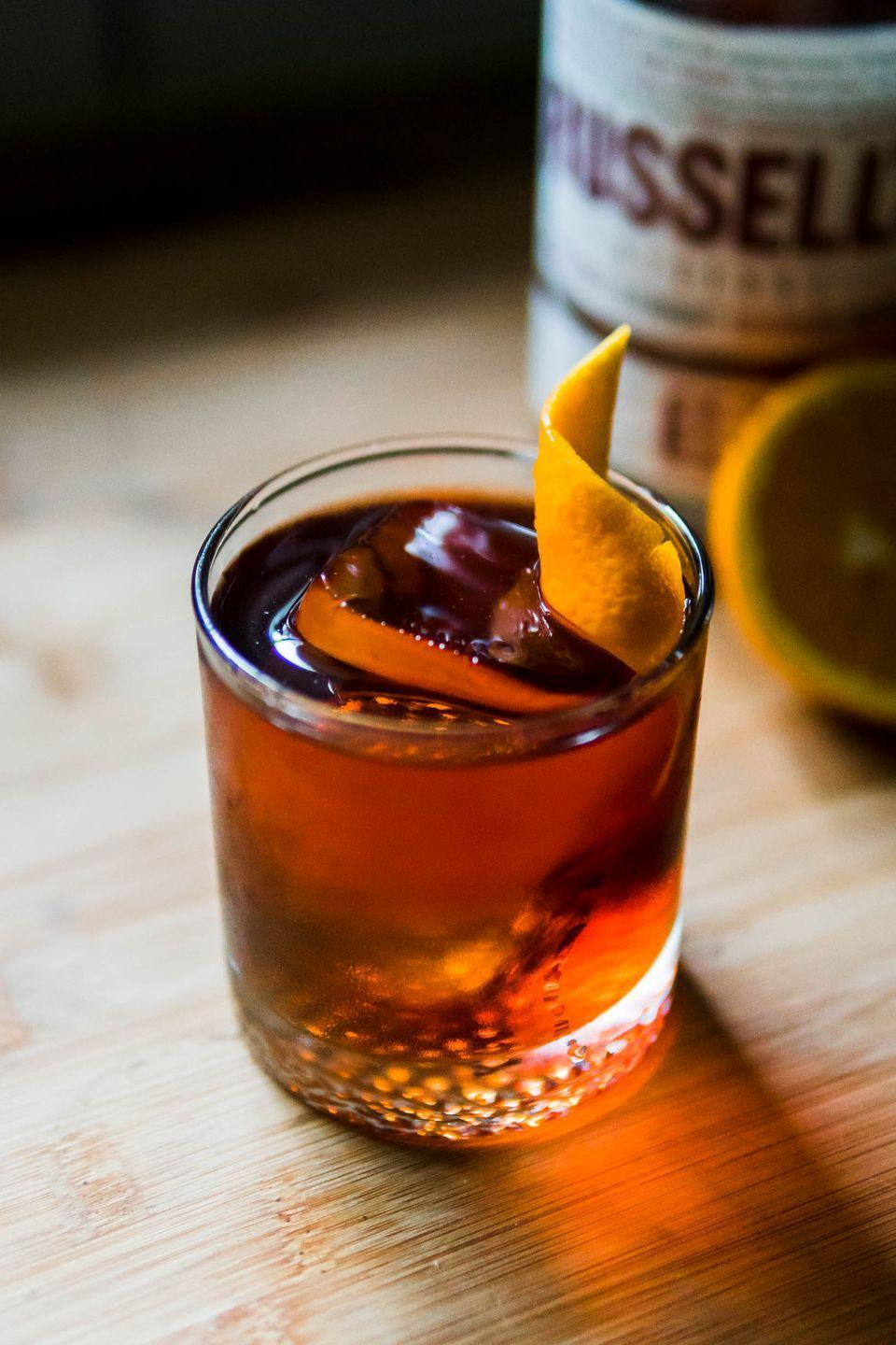 <p><strong>Ingredients</strong></p><p>1 oz Campari<br>1 oz 1757 Vermouth di Torino Rosso<br>1 oz Russell's Reserve 10-Year-Old Bourbon<br>Orange slice, for garnish</p><p><strong>Instructions</strong></p><p> Combine bourbon, vermouth and Campari in a cocktail shaker. Fill with ice and shake vigorously until outside of shaker is frosty (about 30 seconds). Strain into a chilled rocks glass over large ice cube. Garnish with orange slice.</p>