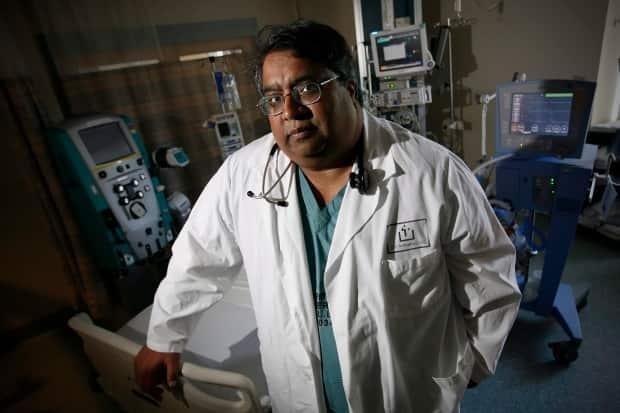 Dr. Anand Kumar, seen here at St. Boniface Hospital in Winnipeg in August 2009, says it may be awhile before long-term care homes can fully reopen.